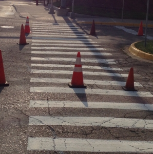 Before: Worn out cross walk paint with safety cones