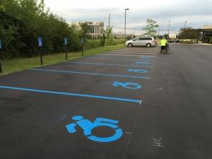 New blue handicap parking painting signage