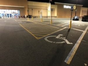 Before: Handicap parking space with worn out and faded painting and stripes