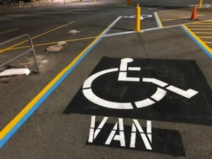 After: Handicap parking space freshly painted and striped