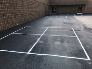 Side view of school four square court with new paint