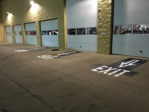 Warehouse exit signage pavement painting