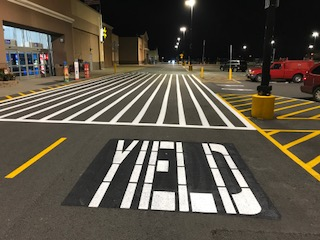 Seal Coating Services Wixom MI - Action Pavement Striping - parking_lot_stencil